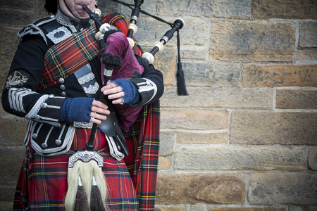 Playing the bagpipes on streets of Edinburgh Stock Photo