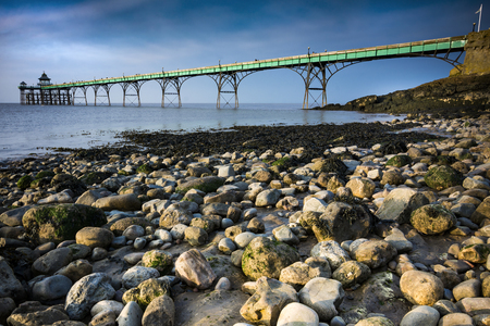 Clevedon pier and beach in sunlight on Somerset coast Stock Photo