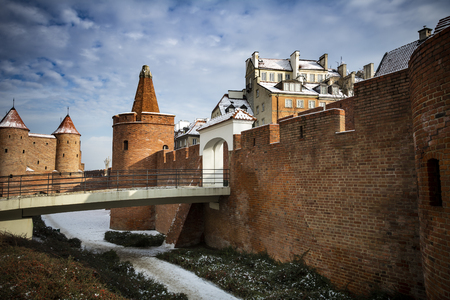 Warsaw city walls in light snow in Poland