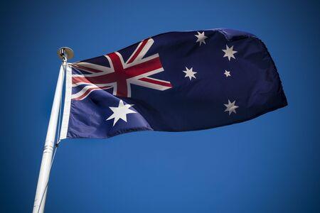 Australian flag flying in the breeze against clear blue sky Stock fotó