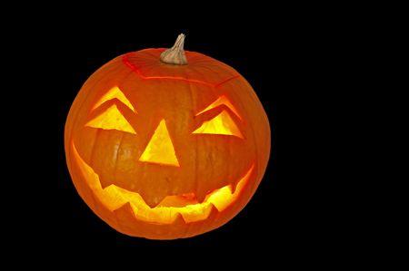 candlelit: candlelit glowing pumpkin lantern isolated on black Stock Photo