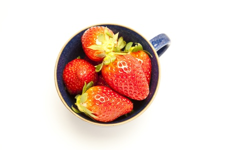 Cup of strawberries on white background