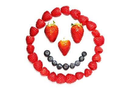 Smiley fruit face on white background