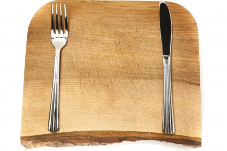 Empty chopping board with cutlery and copy space Stock Photo