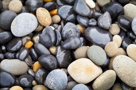 Wet stones on beach