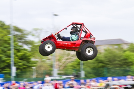 Stunt Buggy flying through the air Editorial