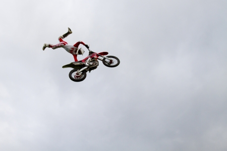 Stunt motorcyclist in the air