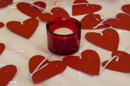 Candle surrounded by love hearts