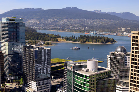 Downtown Vancouver, British Columbia, Canada, looking toward Stanley park, bay and mountains. Standard-Bild - 105960825