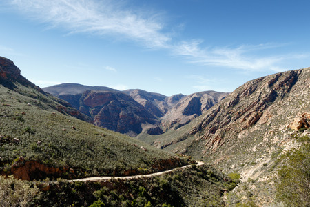 princes street: Leads to The Road - The Swartberg mountains are a mountain range in the Western Cape province of South Africa. It is composed of two main mountain chains running roughly east-west along the northern edge of the semi-arid Little Karoo. Stock Photo