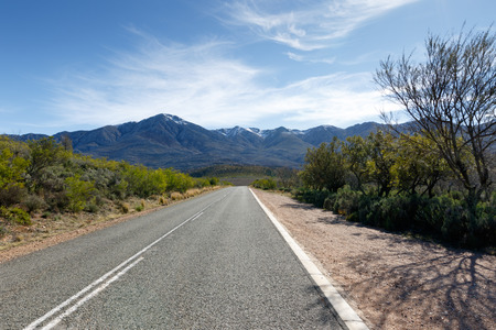 Snow - The Swartberg mountains are a mountain range in the Western Cape province of South Africa. It is composed of two main mountain chains running roughly east-west along the northern edge of the semi-arid Little Karoo. Stock Photo