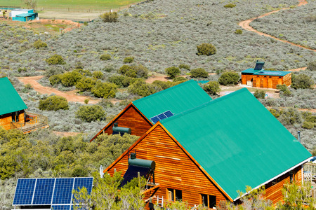 The Travelling Tortoise is situated just outside of De Rust.The off-the-grid eco resort comprises of two mountain chalets, which both feature fully equipped kitchens, lounges with sleeper couches and large decks with braai facilities. The property also of