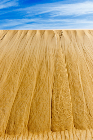Sand dune with the sky in the foreground. Stock Photo