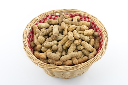 bast basket: Small bast basket filled with many peanuts Stock Photo