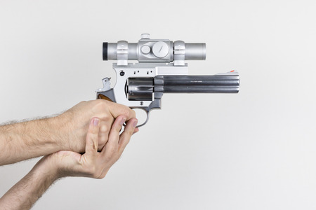 magnum: Shooter holds .357 Magnum revolver with dot sight