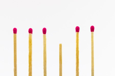 kaput: Six matches with red tips, one is broken Stock Photo