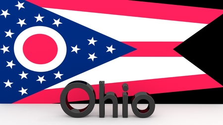 senators: Writing with the name of the US state Ohio made of dark metal  in front of state flag Stock Photo
