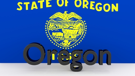 senators: Writing with the name of the US state Oregon made of dark metal  in front of state flag Stock Photo