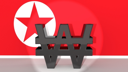 foreign currency: Currency symbol North Korean Won made of dark metal in spotlight in front of North Korean flag