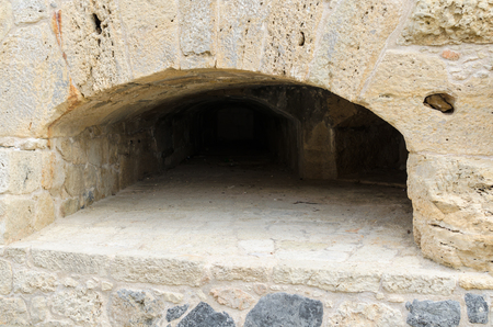 Close-up: embrasure in the stone wall at the old Venetian fortress Koule, Heraklion, Crete, Greece.