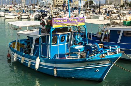 HERAKLION, GREECE - November, 2017: colorful greek fishing boats near the old Venetian fortress Koule, Heraklion port, Crete