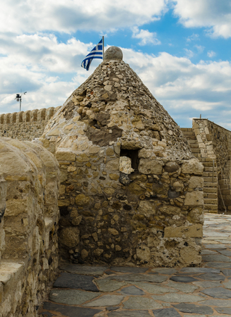 Watchtower with loopholes and fortress wall of old Venetian Fortress Koule in Heraklion, Crete