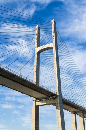 Bottom view of the bridge at Suez Canal. Fragment of the bridge on the background of the bright blue sky Stock Photo