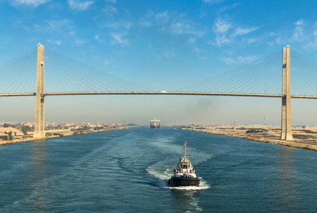 Ships convoy with Maersk line Suez Canal, in the background - the Suez Canal Bridge, also known as Al Salam Bridge, Suez Canal, Egypt