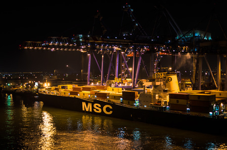 PORT SAID, EGYPT - November 4, 2017: MSC line vessel container ship during loading operations in cargo port.Night landscape. MSC is the worlds second-largest shipping line in terms of container capacity capacity
