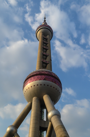 SHANGHAI, CHINA - October 26, 2013: Shanghai TV Tower or Oriental Pearl Radio & TV Tower, rushing into blue sky, China. Shanghai TV Tower - fifth tallest TV tower in the world, 468 meters high Editorial