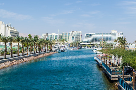 EILAT, ISRAEL - November 7, 2017: entrance to the marina, with promenades, modern hotel complexes, palms, cafes, restaurants and shopping centers. Eilat - famous resort and recreational city in Israel Editorial