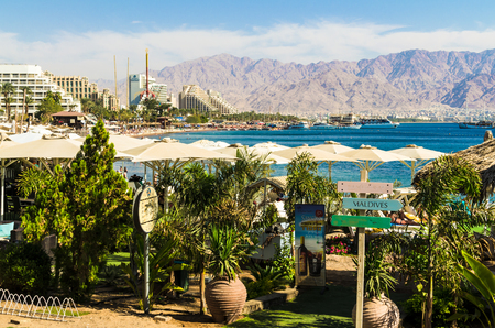 EILAT, ISRAEL - November 7, 2017: Eilat, Israel. Eilat, on the background of urban white buildings and mountain peaks. Travel and tourism concept