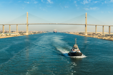 Ship's convoy passing through Suez Canal, in the background - the Suez Canal Bridge, Suez Canal, Egypt