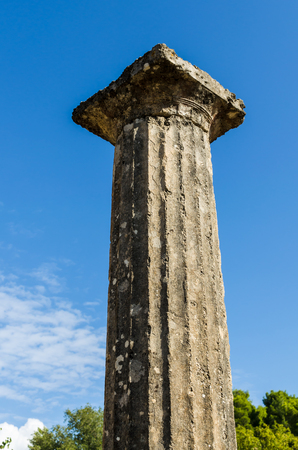 Column of white marble against a blue sky and clouds. Bottom view. Olympia, Peloponnes, Greece
