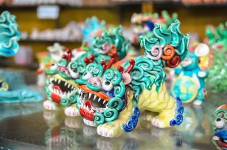 Traditional colorful chinese dragon clay figurines. Selective focus, China. Фото со стока