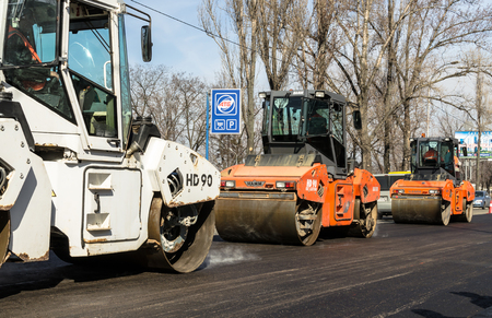 KIEV, UKRAINE - March 29, 2017: Road road works in roadway in Rusanovka district. Kiev, Ukraine. People and construction work concept