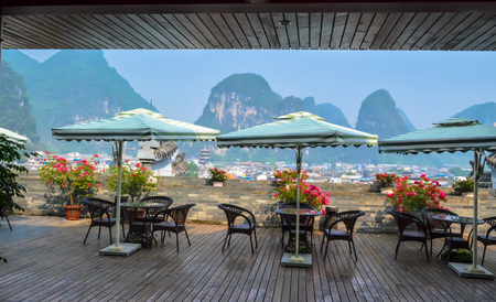 YANGSHUO, CHINA - October 22, 2013: View from the terrace to the mountain peaks. Yangshuo is a popular tourist destination of Guilin Guangxi.