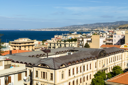 Reggio Calabria, Italy - October 30, 2017: Aerial view of houses, streets and the Strait of Messina between Reggio Calabria and Sicily from the Aragonese Castle in Reggio Calabria, Italy