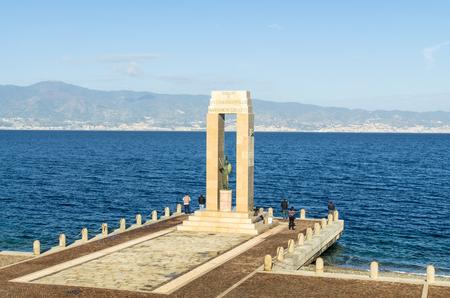 Reggio Calabria, Italy - October 30, 2017: Athena goddess Statue and Monument to Vittorio Emanuele at Arena dello Stretto in Reggio Calabria, Italy. Athena ancient Greek goddess associated with wisdom, handicraft, warfare Редакционное
