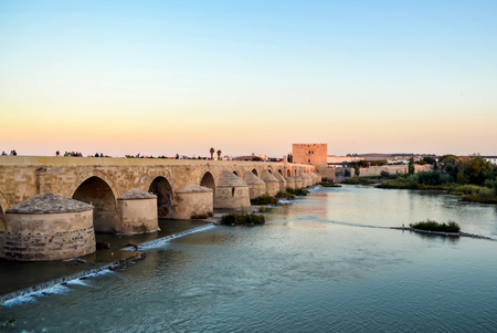 View of the Roman bridge over the Guadalquivir river, going into the distance, October 2016, Cordoba, Spain