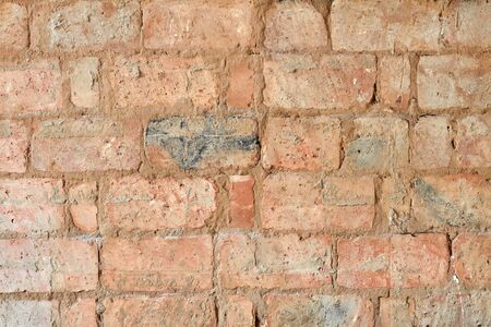 Background of old red vintage brick wall. Background of brick wall texture. Closeup
