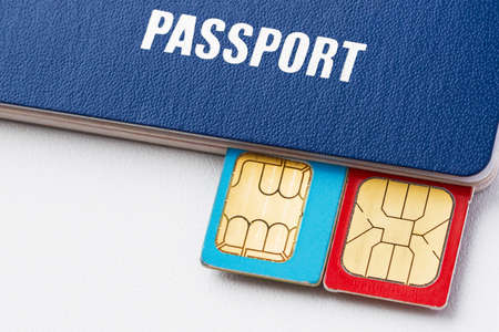 Blue passport with two sim card on the light background. Closeup, selective focus Stock Photo