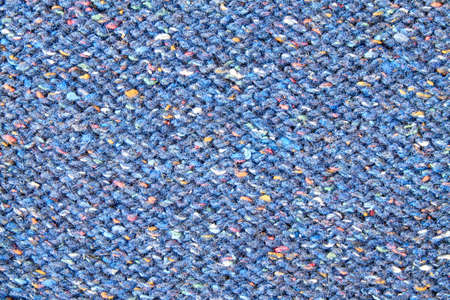 Blue knitted textured background. Closeup