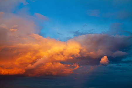 Dramatic bright orange yellow and blue colors of sunset sky