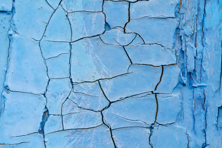 Cracked blue paint as background or texture