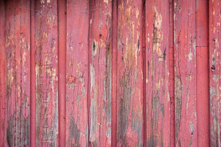 Red painted wood planks as background or texture. Close-up