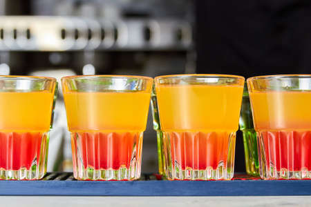 Several multicolored alcoholic drinks shots on the bar counter Stock fotó