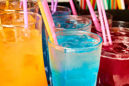 Multicolored alcoholic and non-alcoholic cocktails with ice and straws Stock fotó