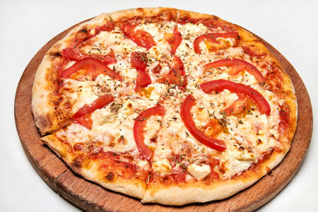 Pizza with bacon, bell pepper, tomatoes and cheese on wooden board. Close-up, selective focus