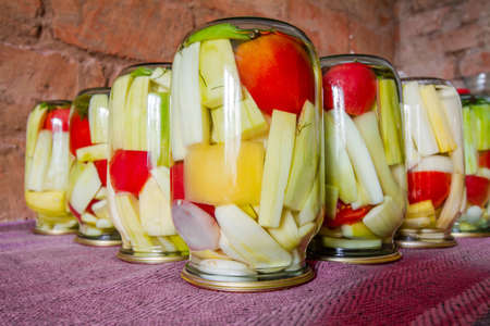 Process of home preserving of zucchini in jars. Canning vegetables for the winter. Closeup, selective focus Stock fotó